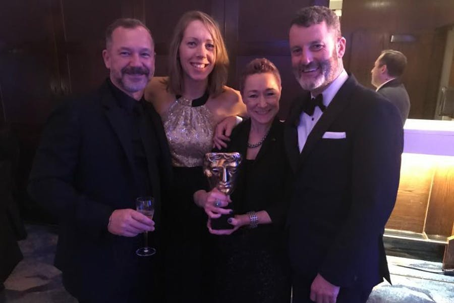 Chloe Chesterton celebrating with the 1917 team at the 2020 BAFTAs